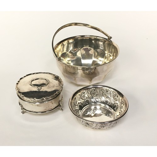 25 - Silver with swing handled bowl, silver 3 leg pill pot, together a silver small embossed bowl