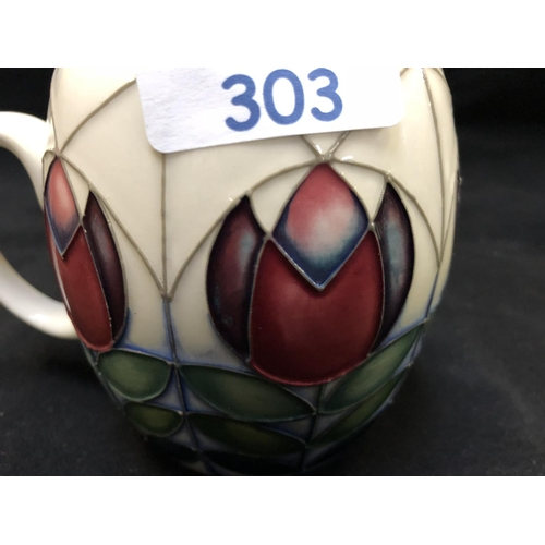 303 - A MOORCROFT POTTERY MUG DECORATED IN THE 'GEOMETRIC TULIPS' PATTERN DESIGNED BY NICOLA SLANEY, SHAPE...