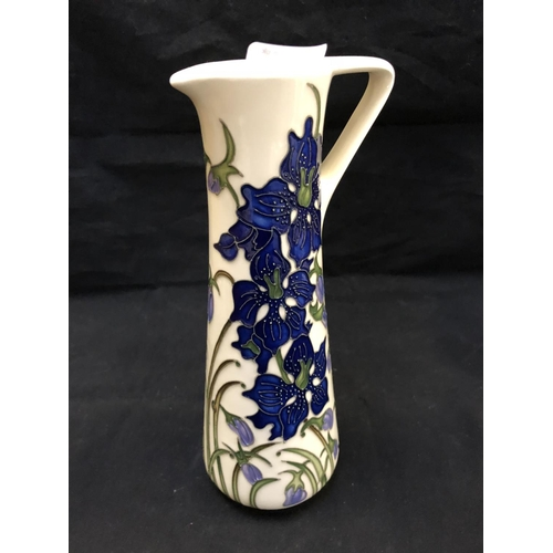 307 - A MOORCROFT POTTERY JUG DECORATED IN THE 'DELPHINIUM' PATTERN DESIGNED BY KERRY GOODWIN, SHAPE NUMBE...