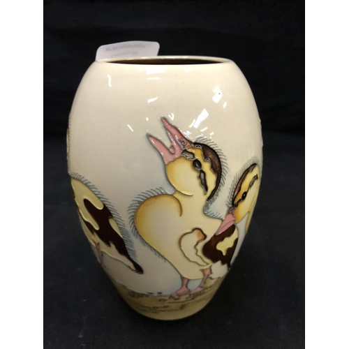 317 - A NUMBERED EDITION (184) MOORCROFT POTTERY VASE DECORATED IN THE 'SPRING DUCKLING' PATTERN DESIGNED ...