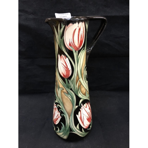 318 - A LIMITED EDITION (30/40) MOORCROFT POTTERY JUG DECORATED IN THE 'RACE AGAINST TIME' PATTERN DESIGNE...