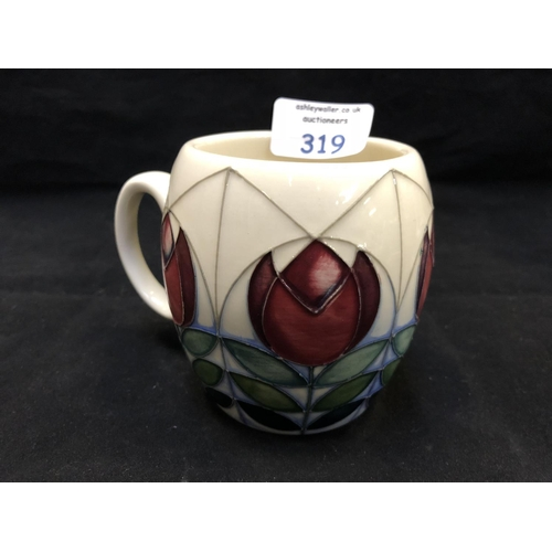 319 - A MOORCROFT POTTERY MUG DECORATED IN THE 'GEOMETRIC TULIPS' PATTERN DESIGNED BY NICOLA SLANEY, SHAPE...