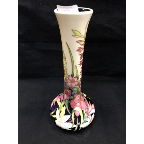 323 - A LIMITED EDITION (19/50) MOORCROFT POTTERY VASE DECORATED IN THE 'WILD GLADIOLI' PATTERN DESIGNED B...