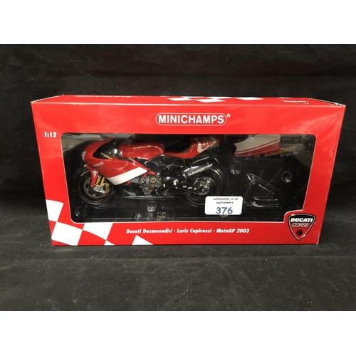 376 - A 'MINICHAMPS' 1:12 SCALE REPLICA MOTO GP RACING BIKE MODEL - DUCATI DESMODECI LORIS CAPIROSSI, 2003...