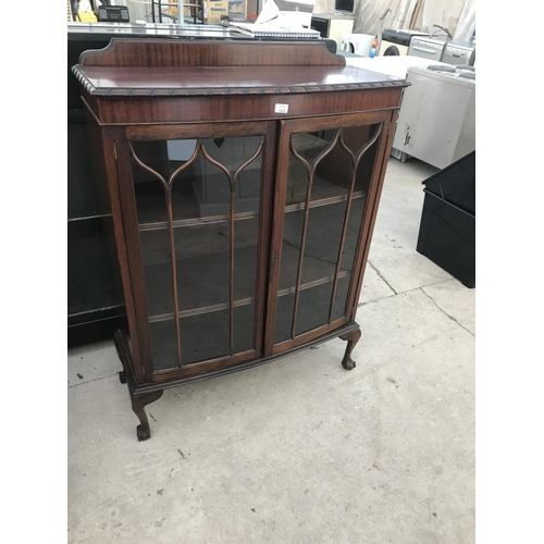 604 - A MAHOGANY DISPLAY CABINET ON CABRIOLE SUPPORTS AND BALL AND CLAW FEET WITH TWO GLAZED PANEL DOORS...