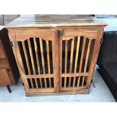 644 - AN INDONESIAN WOOD CABINET WITH TWO SLATTED DOORS...