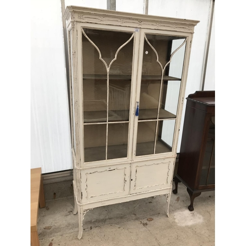 603 - A SHABBY CHIC PAINTED MAHOGANY CABINET WITH TWO LOWER DOORS AND TWO UPPER GLAZED PANEL DOORS...
