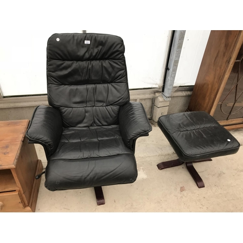 609 - A STRESSLESS STYLE BLACK LEATHER SWIVEL ARMCHAIR AND FOOTSTOOL...