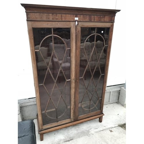 610 - A LARGE MAHOGANY CABINET WITH TWO ORNATE GLAZED PANEL DOORS (NO SHELVES)...