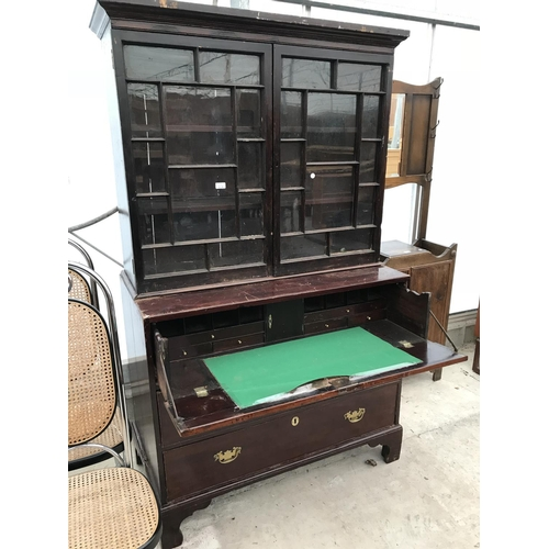 614 - A MAHOGANY SECRETAIRE BOOKCASE WITH BRASS HANDLES AND ESCUTCHEONS, HAVING THREE LOWER DRAWERS, ONE H...