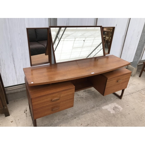 616 - A G PLAN E GOMME TEAK DRESSING TABLE WITH THREE DRAWERS AND UPPER THREE SECTION MIRROR...