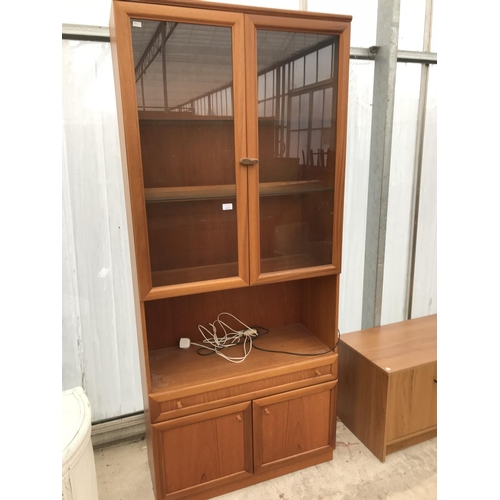 623 - A TEAK CABINET WITH TWO LOWER DOORS AND TWO UPPER SMOKED GLASS DOORS...