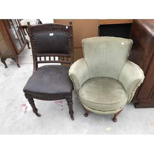 625 - A CRAVED OAK CHAIR WITH STUDDED LEATHER SEAT AND BACK AND AN UPHOLSTERED BEDROOM CHAIR ON MAHOGANY C...