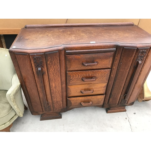 626 - AN OAK SIDEBOARD WITH TWO DOORS AND FOUR CENTRE DRAWERS...