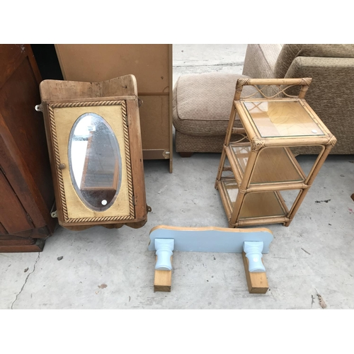 627 - THREE ITEMS - A SMALL PINE CORNER CABINET WITH OVAL BEVEL EDGE MIRROR, AN OAK AND PAINTED SHELF AND ...