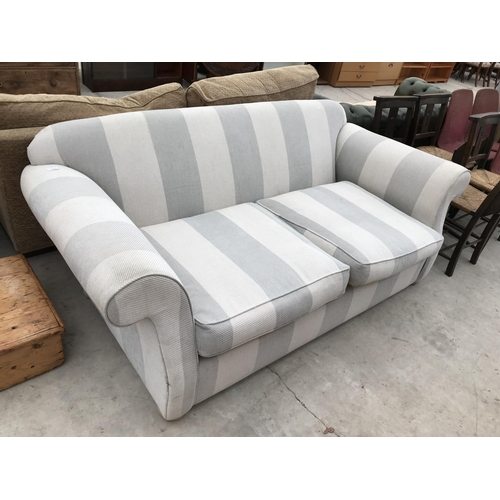 630 - A STRIPED FABRIC TWO SEATER SOFA...