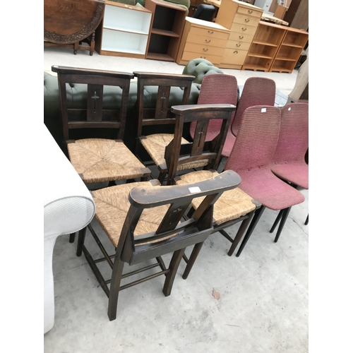 631 - FOUR OAK CHAPEL CHAIRS WITH RUSH SEATS AND PRAYER BOOK POCKETS...