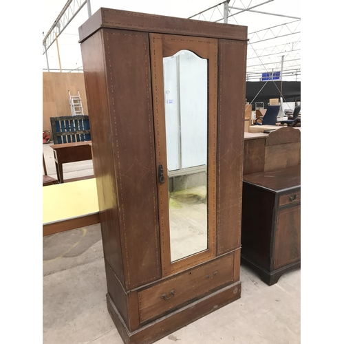 641 - AN INLAID MAHOGANY WARDROBE WITH LOWER DRAWER AND BEVEL EDGE MIRRORED DOOR...