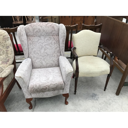 648 - A WING BACK ARMCHAIR AND A A MAHOGANY ARMCHAIR...