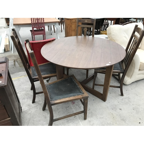 652 - A CIRCULAR INDONESIAN WOOD DINING TABLE AND FOUR OAK DINING CHAIRS...