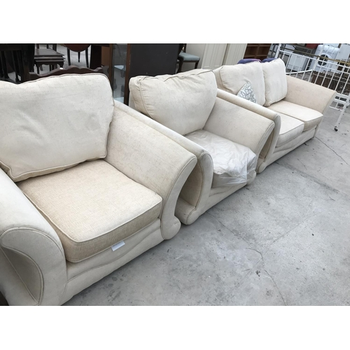 653 - A CREAM TWO SEATER SOFA AND TWO MATCHING ARMCHIARS...