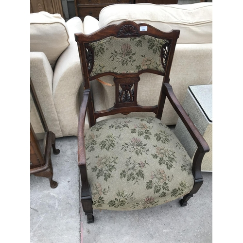 661 - A CARVED OAK ARMCHAIR WITH TAPESTRY UPHOLSTERED SEAT AND BACK...