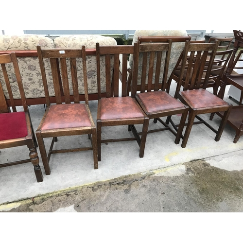 664 - FOUR OAK DINING CHAIRS WITH BROWN LEATHERETTE SEATS...