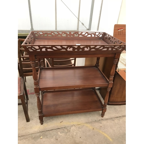 665 - A THREE TIERED MAHOGANY SERVER WITH DECORATIVE FRETWORK GALLERIED TOP...