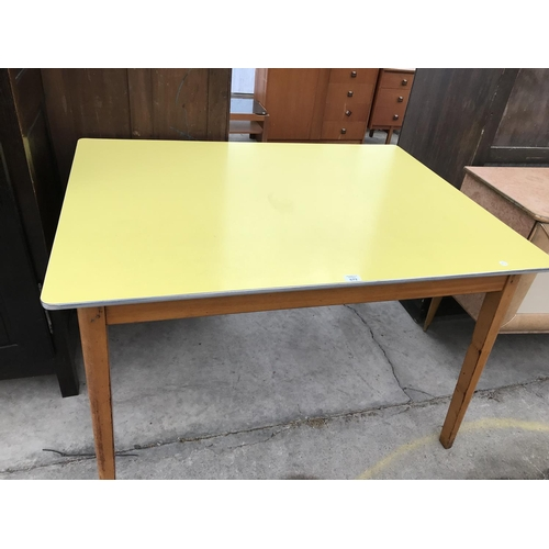 672 - A RECTANGULAR FORMICA TOPPED TABLE ON BEECH SUPPORTS - 122 CM X 91 CM...