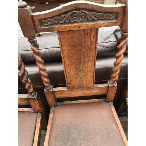 677 - FOUR OAK DINING CHAIRS WITH BARLEY TWIST SUPPORTS AND BACK STRUTS...