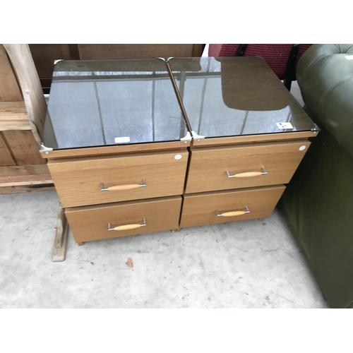 682 - TWO RETRO TEAK EFFECT BEDSIDE CABINETS WITH SMOKED GLASS TOPS...