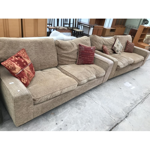 684 - TWO BEIGE FABRIC TWO SEATER SOFAS...