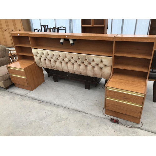 685 - A RETRO SCHRIEBER TEAK BEDHEAD WITH ATTACHED BEDSIDE CABIBETS...