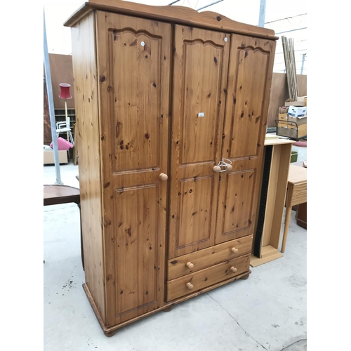 686 - A PINE WARDROBE WITH THREE DOORS AND TWO DRAWERS...