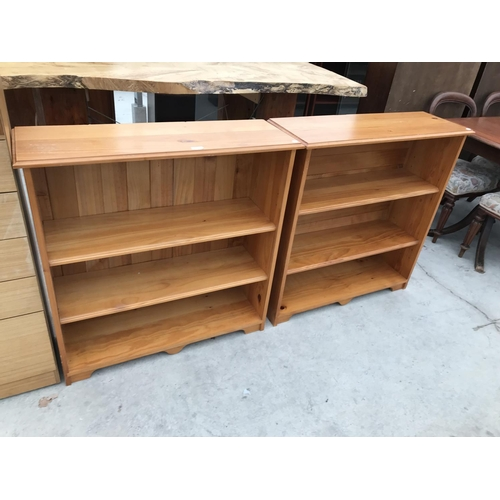 693 - TWO PINE THREE TIER BOOKCASES...