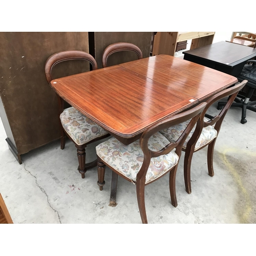 694 - A VICTORIAN MAHOGANY EXTENDING DINING TABLE AND FOUR MAHOGANY BALLOON BACK DINING CHAIRS...