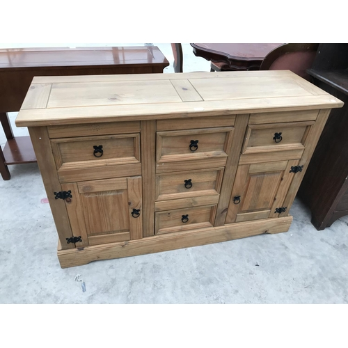 699 - A RUSTIC PINE CABINET WITH TWO DOORS AND FIVE DRAWERS...