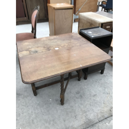 701 - TWO ITEMS - AND OAK DROP LEAF DINING TABLE ON BARLEY TWIST SUPPORTS AND AN OAK BEDSIDE CABINET...