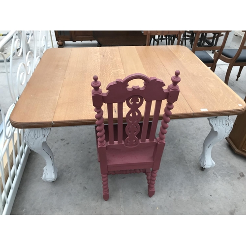 709 - TWO SHABBY CHIC ITEMS - AN OAK DINING TABLE ON HEAVILY CARVED CABRIOLE SUPPORTS AND A HEAVILY CARVED...