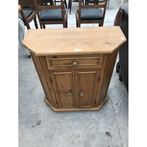 710 - A PINE SIDE CABINET WITH TWO DOORS AND ONE DRAWER...
