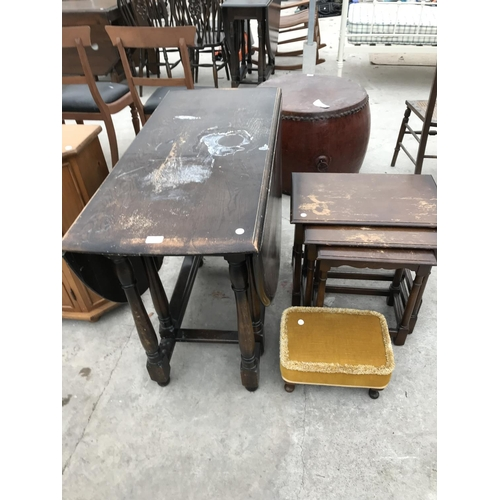 711 - THREE RESTORATION ITEMS - AN OAK DROP LEAF DINING TABLE, AND OAK NEST OF TABLES AND AN UPHOLSTERED F...