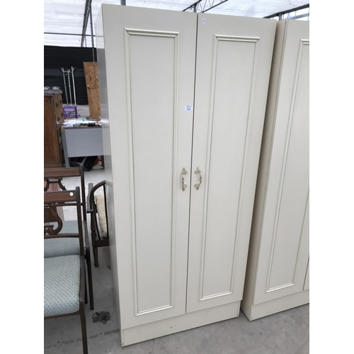 714 - TWO CREAM WARDROBES AND TWO FIVE TIER PINE EFFECT BOOKCASES...