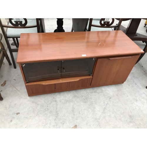 717 - A LOW TEAK CABINET WITH TWO SOLID AND TWO SMOKED GLASS DOORS...