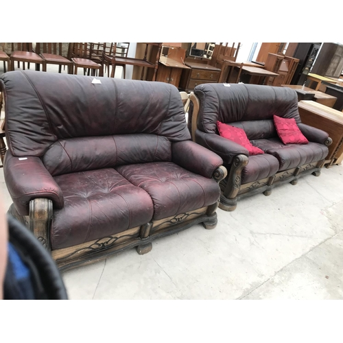 724 - TWO OAK AND LEATHER TWO SEATER SOFAS (FOR RESTORATION)...