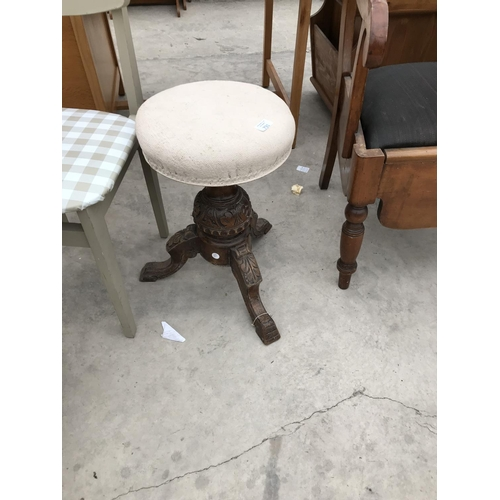731 - A HEAVILY CARVED MAHOGANY SWIVEL PIANO STOOL...