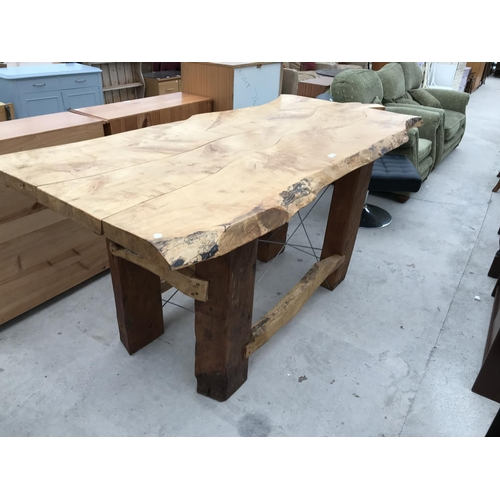 735 - A RUSTIC SAWN TOP SYCAMORE DINING TABLE ON VERY HEAVY SUPPORTS - APPROX 220 CM X 95 CM...