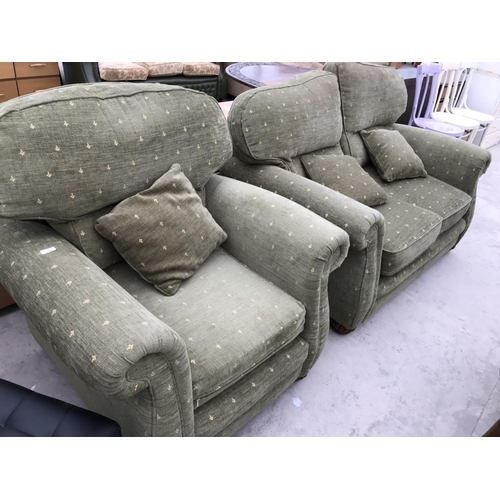 737 - A TWO SEATER FABRIC SOFA AND MATCHING ARMCHAIR...