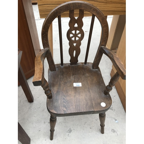 740 - A CHILD/ INFANT'S WHEELBACK OAK ARMCHAIR - HEIGHT 63 CM...