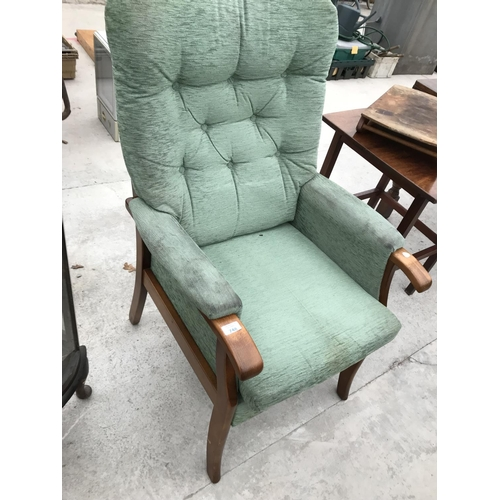 748 - A MAHOGANY FRAMED BUTTON BACK ARMCHAIR...