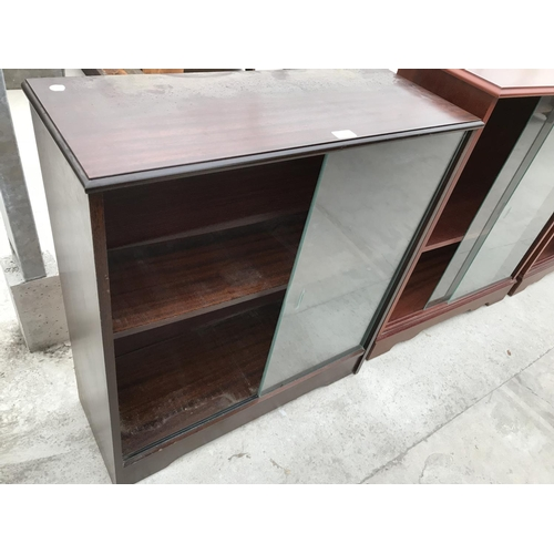752 - A MAHOGANY BOOKCASE WITH SLIDING GLASS DOORS...